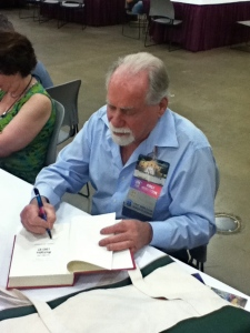 The grandmaster, Robert Silverberg, signing at the 71st Worldcon in San Antonio.